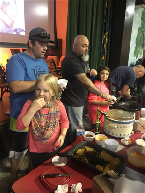 Children and Dads eating Chili