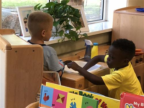 two boys playing in dramatic play center
