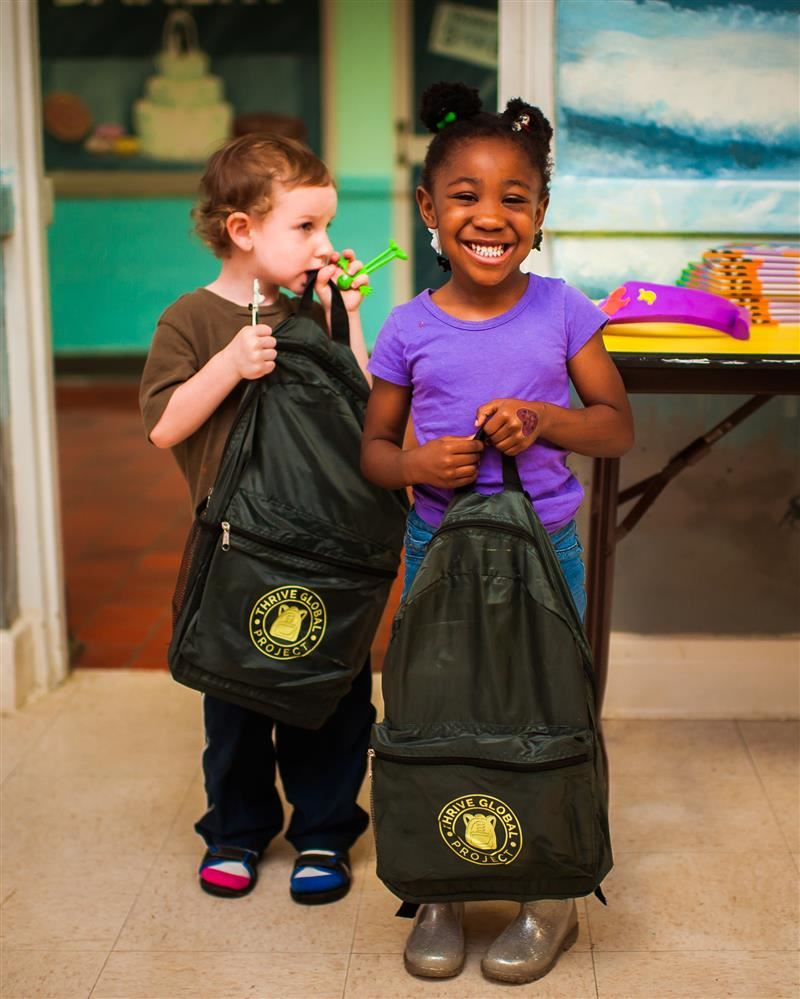 two children with bookbags