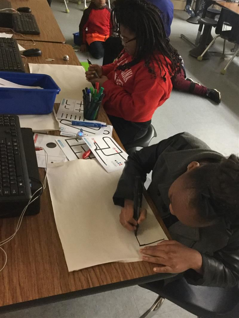 Students drawing paths for coding